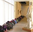 School group visit.  Mr Gladstone watches over the student's bags  (Image: M. Cook)