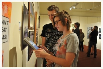 Exhibiting Youth Emergent Artists, Gabriella Zussino and Beau Moloney, vote at the iPad kiosks for their four favourite works for the QAL People's Choice Awards.