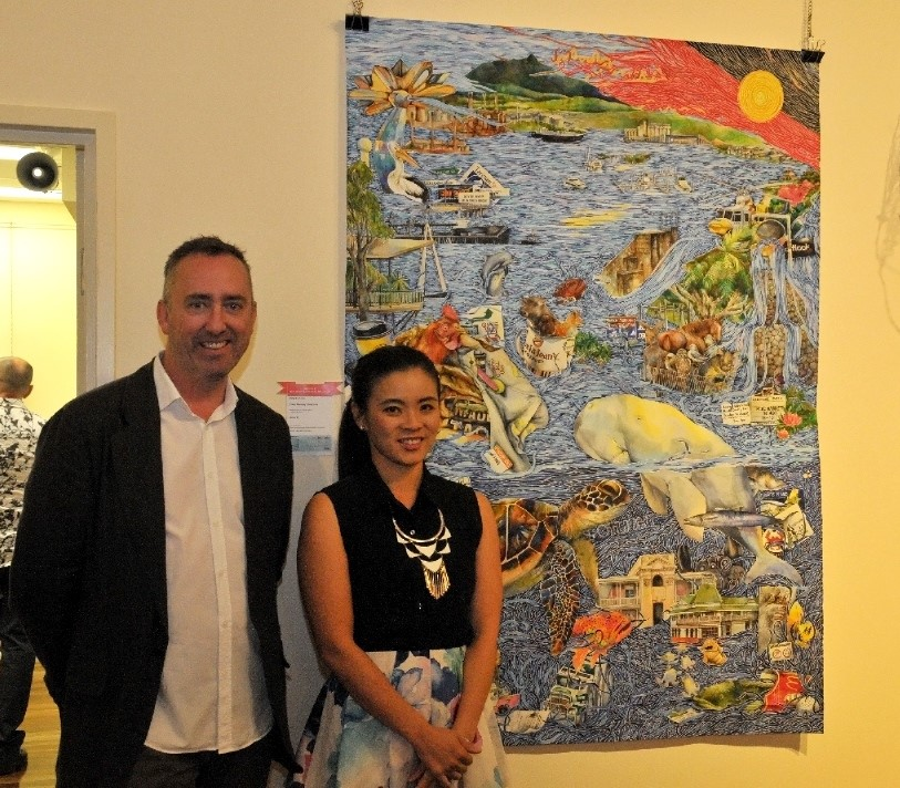 'The 41st Rio Tinto Martin Hanson Memorial Art Awards 2016' Judge Jason Smith and award winning artist Ping Carlyon, next to Ping's work 'Good Morning Gladstone'