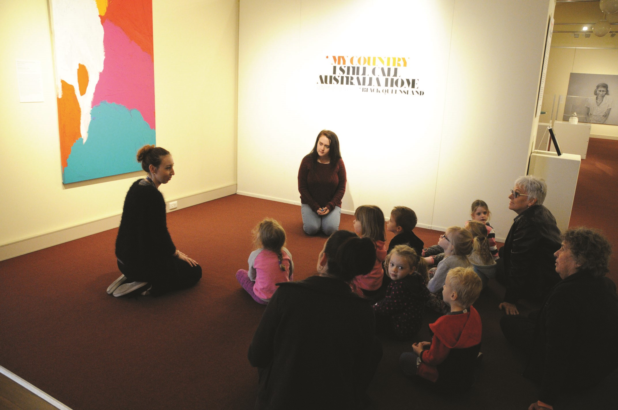 Children from Stepping Stones on an exhibition tour with GRAGM's Sarah Robertson and Chloe Wheatland